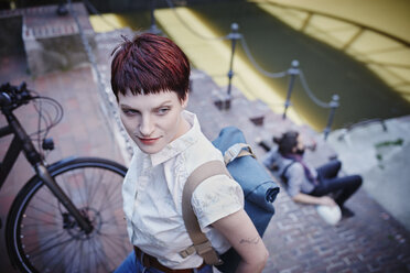 Germany, Hamburg, portrait of woman with dyed hair and backpack - RORF00674