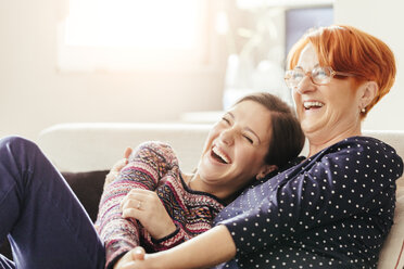 Happy adult daughter with mother at home - ZEDF00528