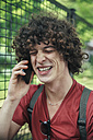 Young man laughing on the phone - RTBF00710