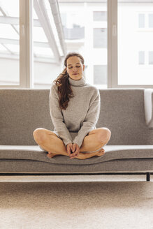 Woman with closed eyes sitting on couch - JOSF00641
