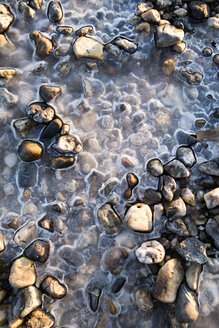 Frozen lake with stones - NDF00630