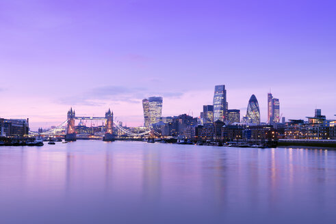 UK, London, skyline with River Thames and Tower Bridge at dusk - BRF01434