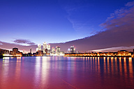 UK, London, skyline with Canary Wharf skyscrapers at dawn - BRF01437