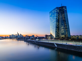 Germany, Frankfurt, European Central Bank and skyline in the background at sunset - AMF05301