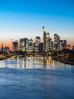 Germany, Frankfurt, view to skyline with Floesserbruecke and Main River in the foreground at twilight - AMF05304