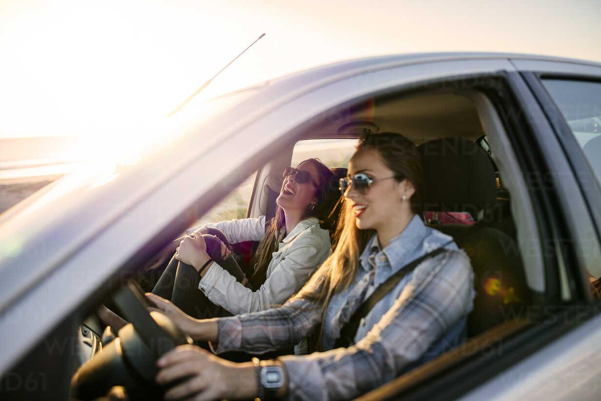 Two young women traveling in a car - KIJF01331 - Kiko Jimenez/Westend61