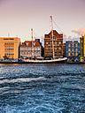 Curacao, Willemstad, schooner and colorful houses at waterfront promenade - AMF05306