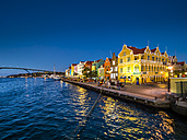 Curacao, Willemstad, Punda, colorful houses at waterfront promenade in the evening - AMF05309