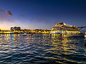 Curacao, Willemstad, cruise liner in the harbor in the evening - AM05312