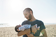 Father with his newborn baby girl on the beach - GEMF01522