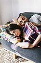 Young couple taking a nap on the sofa - VABF01211