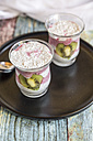 Two glasses of chia pudding with heart-shaped kiwi slices - SARF03248