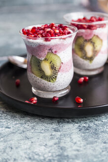 Two glasses of chia pudding with heart-shaped kiwi slices and pomegranate seed - SARF03251