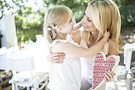 Happy mother receiving heart form her daughter - WESTF22795