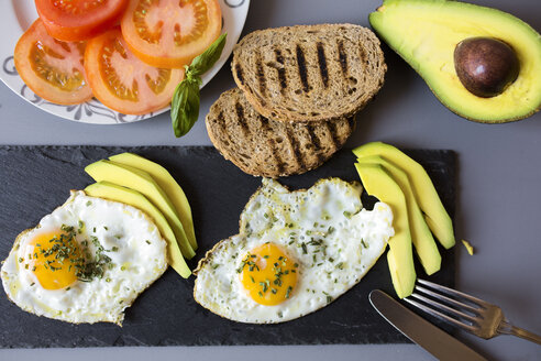 Breakfast with eggs, avovados, tomatoes and toasted bread - GIOF02143