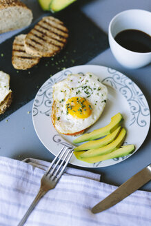 Breakfast with eggs, avocado, bread and coffee - GIOF02155