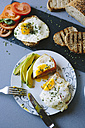 Breakfast with eggs, avocado, bread and tomatoes - GIOF02158