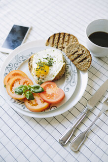 Breakfast wth eggs, avocados, coffe and tomatoes - GIOF02164