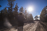 Spain, Tenerife, photographer taking picture on dirt road - SIPF01440
