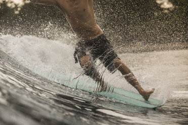Indonesia, Java, close-up of man surfing - KNTF00700