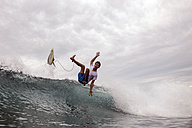 Indonesia, Java, man surfing - KNTF00709