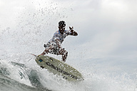 Indonesia, Java, man surfing - KNTF00733