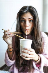 Young woman eating Chinese noodles - VABF01245