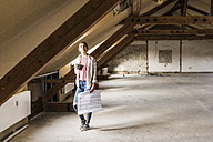 Young woman contemplating the renovation of her new home - UUF10086