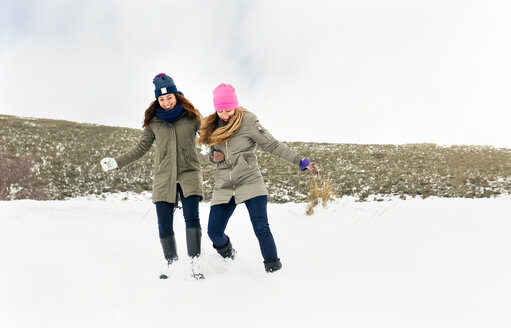 Two friends having fun in the snow - MGOF03022