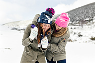 Two friends having fun in the snow - MGOF03037