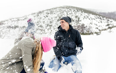 Friens having a snowball fight in the snow - MGOF03049