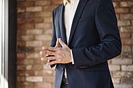 Businessman with folded hands - KNSF01163