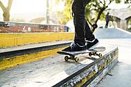 Legs of a skateboarder in a skatepark - KKAF00517