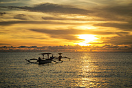 Indonesia, Bali, sunset over the ocean with boats - KNTF00742