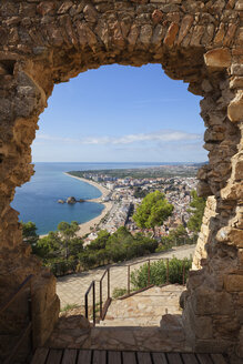 Spain, Catalonia, Blanes town, framed view trough the gate of St. John Castle - ABOF00172