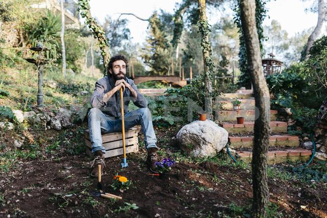 Man in garden having a break from gardening - JRFF01276