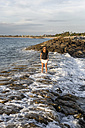 Indonesia, Bali, woman standing in the sea - KNTF00789