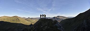 UK, North Wales, Snowdonia, Nantlle Ridge, silhouette of three mountaineers - ALRF00848