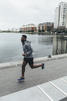 Irlenad, Dublin, young man running at waterfront promenade - BOYF00667