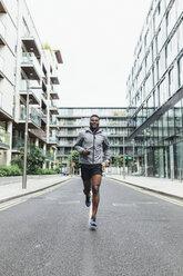 Irlenad, Dublin, young man running in the city - BOYF00685