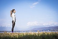 Woman standing at a lake - SIPF01461