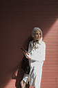 Portrait of mature woman with cell phone and handbag - GIOF02309