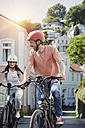 Germany, Hamburg, Blankenese, family riding e-bikes - RORF00694