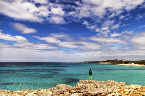 Spain, Menorca, Son Bou, man at the coast - SMAF00707