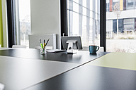 Interior of an office with digital tablet on desk - UUF10200