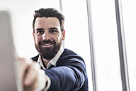Young businessman using digital tablet - UUF10203