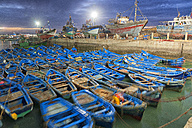 Morocco, Essaouira, blue fishing boats in the harbour at twilight - DSGF01618