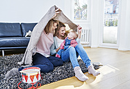 Grandmother, mother and baby girl playing in living room - FMKF03611