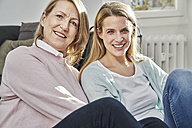 Portrait of smiling adult daughter and mother - FMKF03614