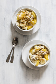 Bowl of granola with oat flakes, natural yoghurt, ananas and banana - EVGF03125